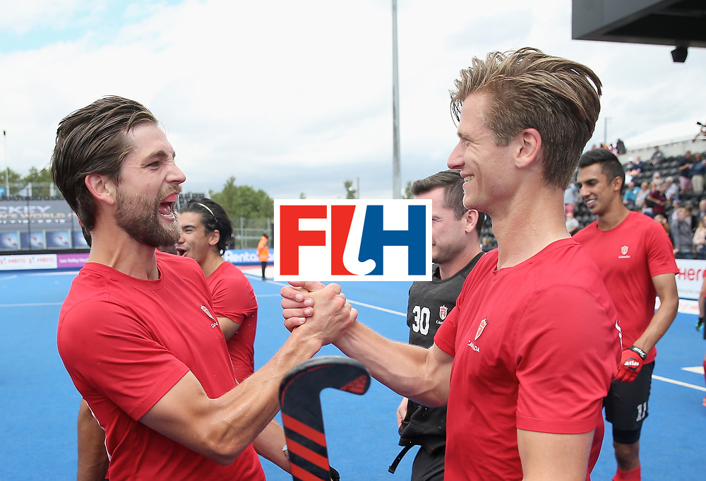 LONDON, ENGLAND - JUNE 25:  Iain Smythe of Canada and Foris Van Son of Canada embrace after the 5th/6th place match between India and Canada on day nine of the Hero Hockey World League Semi-Final at Lee Valley Hockey and Tennis Centre on June 25, 2017 in London, England.  (Photo by Alex Morton/Getty Images)