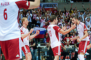 (L-R) Jakub Jarosz and Michal Kubiak and Fabian Drzyzga all from Poland celebrate winning point and victory after the 2013 CEV VELUX Volleyball European Championship match between Poland v Slovakia at Ergo Arena in Gdansk on September 22, 2013.<br /> <br /> Poland, Gdansk, September 22, 2013<br /> <br /> Picture also available in RAW (NEF) or TIFF format on special request.<br /> <br /> For editorial use only. Any commercial or promotional use requires permission.<br /> <br /> Mandatory credit:<br /> Photo by &copy; Adam Nurkiewicz / Mediasport