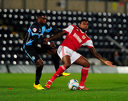 Bristol City's Jay Emmanuel-Thomas controls the ball under pressure from Wycombe Wanderers' Kortney Hause - Photo mandatory by-line: Joe Dent/JMP - Tel: Mobile: 07966 386802 08/10/2013 - SPORT - FOOTBALL - London Road Stadium - Peterborough - Peterborough United V Brentford - Johnstone Paint Trophy