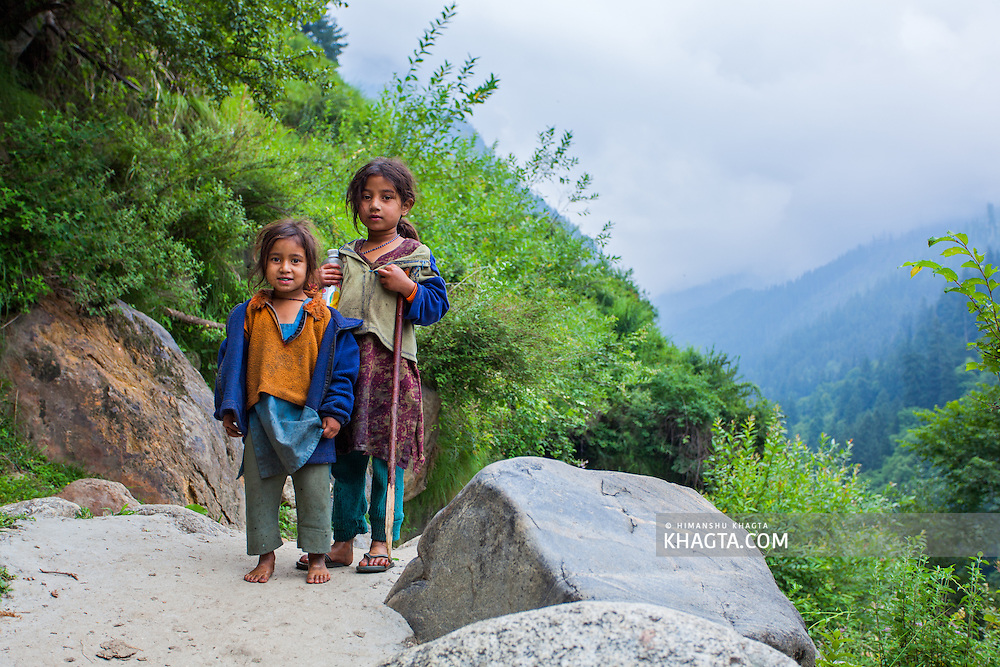 Two young girls pose for a photograph on the hike to Kheerganga. Pictures from the Parvati valley in Kullu, Himachal Pradesh, India