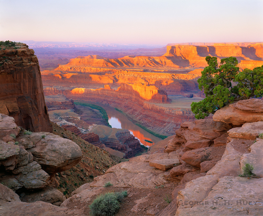 0360-1006 ~ Copyright: George H.H. Huey ~ The Colorado River and Canyonlands National Park from Dead Horse Point State Park, Utah.
