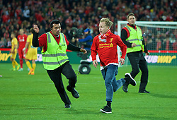 ADELAIDE, AUSTRALIA - Monday, July 20, 2015: A supporter runs onto the pitch after Liverpool's 2-0 victory over Adelaide United during a preseason friendly match at the Adelaide Oval on day eight of the club's preseason tour. (Pic by David Rawcliffe/Propaganda)