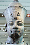 King Amenhotep III (1390-1352 BC) , Red granite head from the temple of Mut, Karnak, Egypt. 18th Dynasty, around 1350 BC