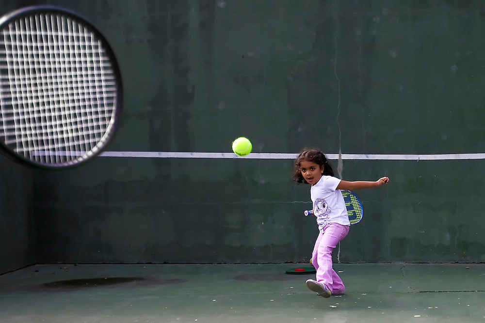 NAPLES, FL - January 17, 2010 -- Zaara Kuttemperoor, 4, plays tennis with her father, Sanjay, at the Arthur L. Allen Tennis Center in Naples, Fla., on Sunday, January 17, 2010.