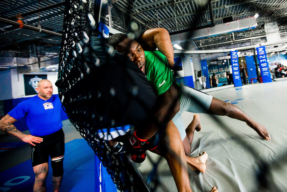 """BOCA RATON, Fla. (April 27, 2015) – MMA fighter Anthony """"Rumble"""" Johnson spars with Linton Vassell during training for his upcoming match against Jon Jones - who was replaced by Daniel Cromier after Jones' legal issues - at Jaco Hybrid Training Center in Boca Raton, Florida. (Photo by Chip Litherland for ESPN the Magazine)"""