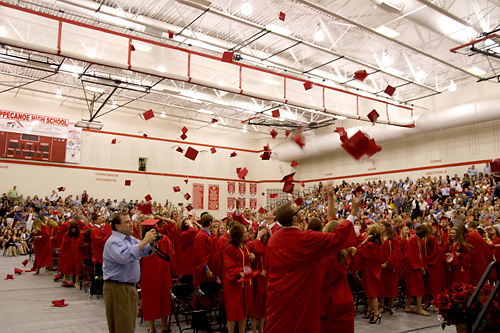 Following the turing of the tassel, the new graduates celebrate by tossing their caps in the air and shooting 'silly string' during the 134th annual commencement of Tippecanoe High School inside their gymnasium, Sunday, May 29, 2011.
