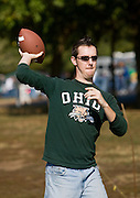 18455.Bill Burke, Ohio University Alum of 2004, throws the football around while tailgating before the game on Saturday, October 13, 2007 in Athens, Ohio..Photo by Kevin Riddell