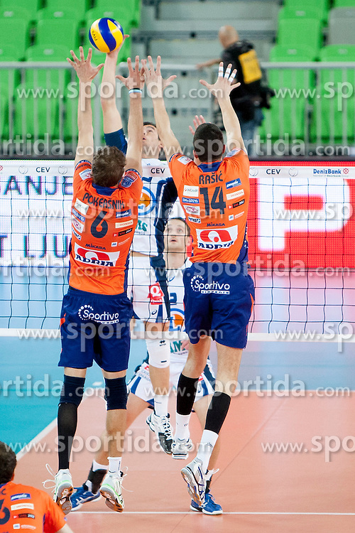Jan Pokersnik #6 and Milan Rasic #14 of ACH Volley during volleyball match between ACH Volley (SLO) and Tours VB (FRA) in 3rd Round of CEV Champions League on November 5, 2013 in Arena Stozice, Ljubljana, Slovenia. (Photo by Urban Urbanc / Sportida)