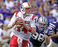 Louisville quarterback Hunter Cantwell (14) rolls out against pressure from Kansas State defensive end Ian Campbell (98) in the first half, at Bill Snyder Family Stadium in Manhattan, Kansas, September 23, 2006.  The 8th ranked Louisville Cardinals beat K-State 24-6.