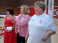 "6 Oct. 2011 -- ST. LOUIS. --  Rosati-Kain High School president Sister Joan Andert (right), SSND, joins Lindsay Tischer (center) and Kathleen Schue, both of SSM St. Mary's Health Center, in acknowledging the funds raised during a ""pink game"" between Rosati-Kain and Bishop DuBourg High School to benefit SSM St. Mary's Health Care Center's Cancer Care at DuBourg in St. Louis Oct. 6, 2011. The even honored Sister Andert, who is currently undergoing treatment for breast cancer. Photo © copyright 2011 Sid Hastings."