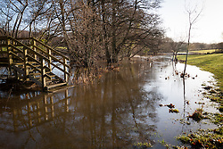 © Licensed to London News Pictures. 02/01/2014. River Blackwater, Hampshire, UK. A footpath bridge blocked by flooding in fields along the River Blackwater near Romsey in Hampshire, UK. River levels are high following a night of wet and windy weather. More wet and windy weather is forecast. Photo credit : Rob Arnold/LNP