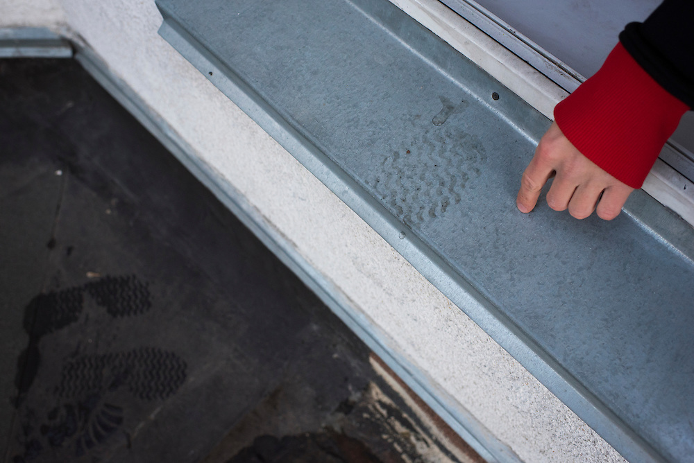 Extreme climber Mustang Wanted gestures to his footprint on a window sill leading to the roof of a 26-storey building on February 19, 2017 in the Shevchenkovski District of Kiev, Ukraine.