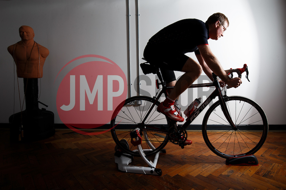 Heart transplant recipient Kevin Mashford trains in his Bristol office for a charity cycle ride from Bristol to Newcastle in memory of his donor, who was himself a keen cyclist. (More information at www.team-mash.co.uk) - Photo mandatory by-line: Rogan Thomson/JMP - Mobile: 07966 386802 - 19/05/2015 - SPORT - Bristol, England - Temple Studios - Bristol Sport meets Kevin Mashford.