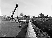 Kinsale Gas Pipeline to Dublin.1982.16.08.1982.08.16.1982.16th August 1982.The Kinsale to Dublin Gas Pipeline was scheduled to be commissioned in Jan '83..Picture of one of the final sections of pipe being installed.The picture was taken at Inchicore,Dublin on the banks of The Grand Canal