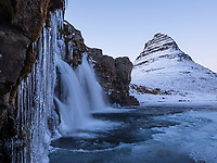 Kirkjufellsfoss waterfall at dusk / twilight. Kirkjufell Mountain in background. Snæfellsnes Peninsula, West Iceland.