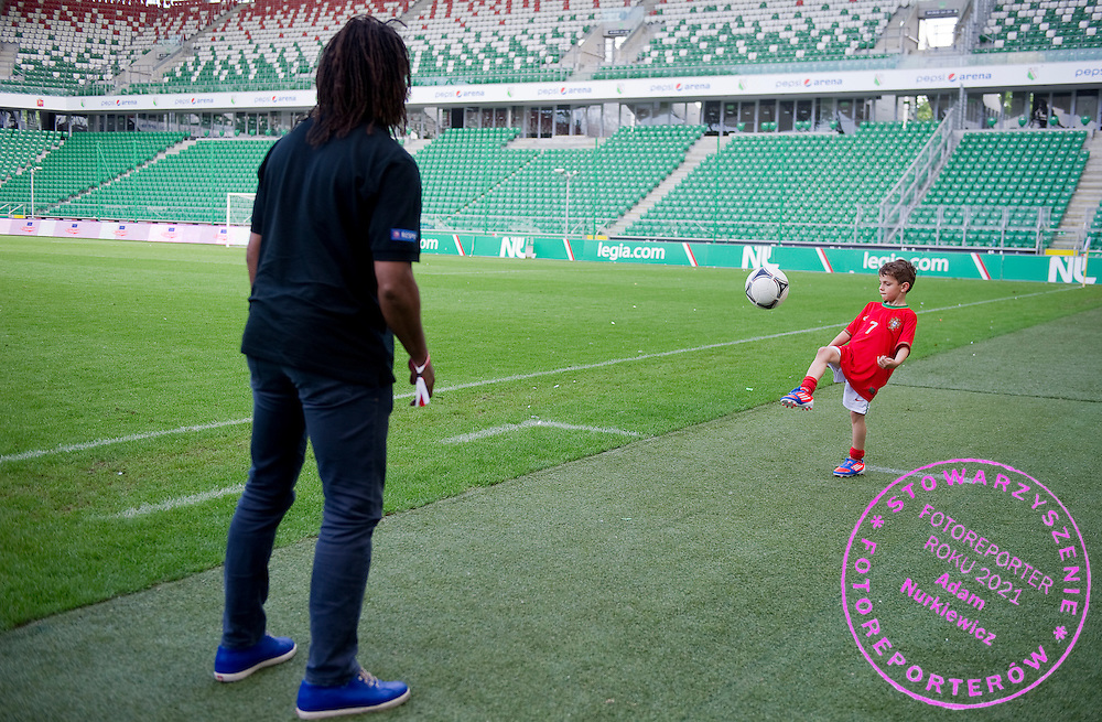 (L) Christian Karembeu - Special Olympics Ambassador  former French soccer player and current scout for Arsenal Football Club and (R) Kuba Zewlakow (son of Michal) plays soccer before final match between SO Serbia (red) and SO Romania (white) during the 2013 Special Olympics European Unified Football Tournament in Warsaw, Poland.<br /> <br /> Poland, Warsaw, June 08, 2012<br /> <br /> Picture also available in RAW (NEF) or TIFF format on special request.<br /> <br /> For editorial use only. Any commercial or promotional use requires permission.<br /> <br /> <br /> Mandatory credit:<br /> Photo by © Adam Nurkiewicz / Mediasport