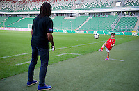 (L) Christian Karembeu - Special Olympics Ambassador  former French soccer player and current scout for Arsenal Football Club and (R) Kuba Zewlakow (son of Michal) plays soccer before final match between SO Serbia (red) and SO Romania (white) during the 2013 Special Olympics European Unified Football Tournament in Warsaw, Poland.<br /> <br /> Poland, Warsaw, June 08, 2012<br /> <br /> Picture also available in RAW (NEF) or TIFF format on special request.<br /> <br /> For editorial use only. Any commercial or promotional use requires permission.<br /> <br /> <br /> Mandatory credit:<br /> Photo by &copy; Adam Nurkiewicz / Mediasport