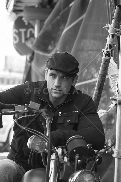handsome man sitting on a motorcycle in New York