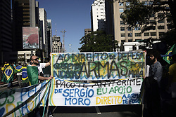 May 26, 2019 - SãO Paulo, São Paulo, Brazil - São Paulo (SP), 26/05/2019 - BRAZIL-GOVERNMENT-BOLSONARO-SUPPORTERS-DEMO - Supporters of Brazilian President Jair Bolsonaro demonstrate along Paulista Avenue in Sao Paulo on May 26, 2019 to shore up the ultraconservative government as it faces growing opposition, while marches are planned across Brazil. - Bolsonaro, who took power in January on a promise to revive Latin America's biggest economy, has seen his popularity plunge as rising unemployment and education spending freezes fuel opposition to his administration, which is plagued by infighting. (Credit Image: © Cris Faga/ZUMA Wire)