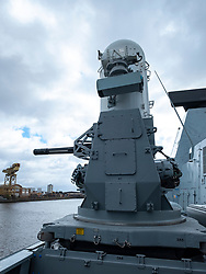 24 March, 2109, Glasgow, Scotland, UK. HMS Defender Type 45 Destroyer berthed at dock in Govan during visit to Glasgow, Scotland, UK. Pictured Phalanx CIWS consisting of a radar-guided 20 mm Vulcan cannon mounted on a swivelling base