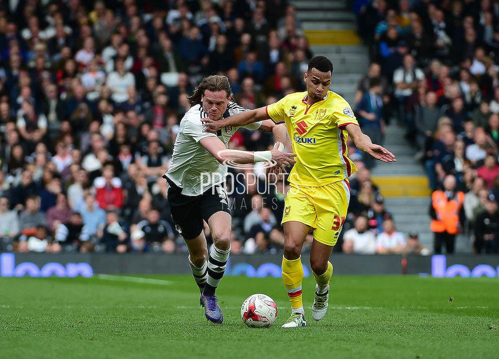 Fulham Defender Richard Stearman (5) tackling MK Dons Josh Murphy during the Sky Bet Championship match between Fulham and Milton Keynes Dons at Craven Cottage, London, England on 2 April 2016. Photo by Jon Bromley.