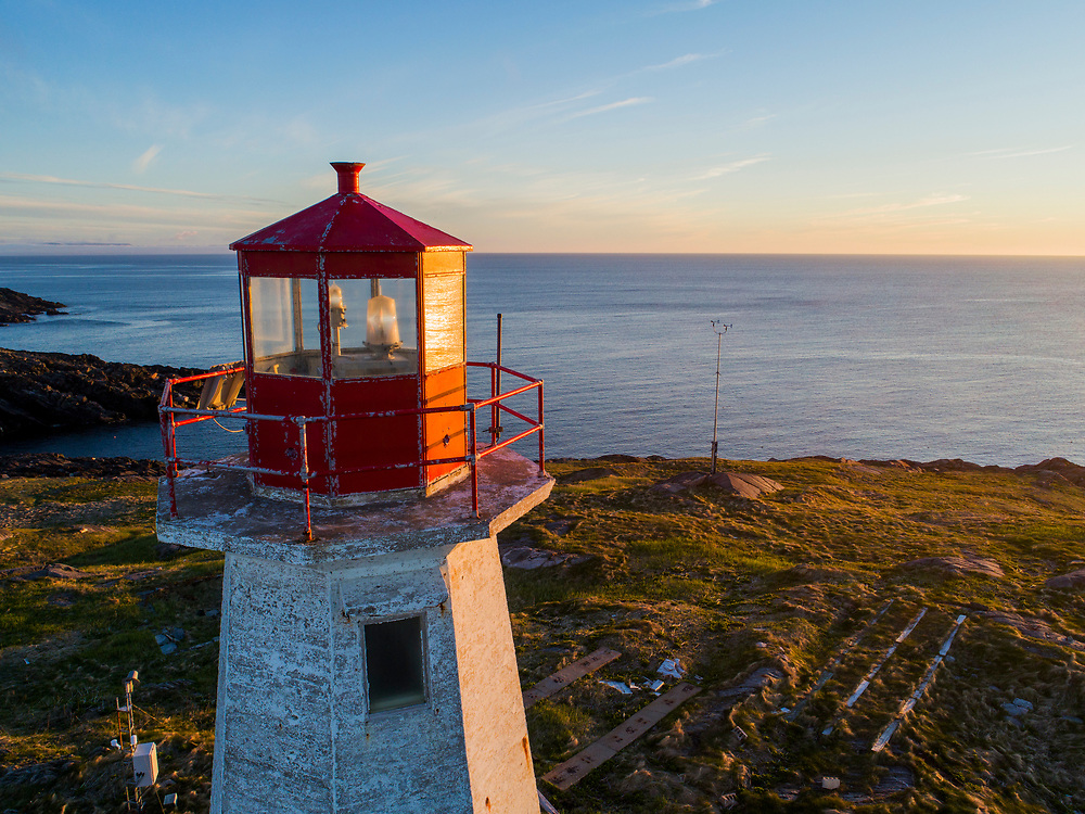 Canada, Nova Scotia, Aerial view of windswept St. Paul Island Lighthouse in Cabot Strait at sunset on summer evening