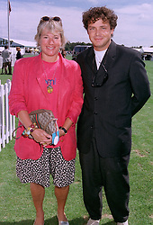 The HON.CAROL THATCHER daughter of former Prime Minister Margaret Thatcher and MR MARCO GRASS, at a polo match in Berkshire on 27th July 1997. MAR 44