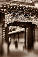 A sepia abstract of a Buddhist Temple gateway.