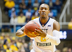 Nov 13, 2015; Morgantown, WV, USA; West Virginia Mountaineers guard Jevon Carter passes to a teammate during the first half against the Northern Kentucky Norse at WVU Coliseum. Mandatory Credit: Ben Queen-USA TODAY Sports