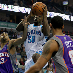 Nov 19, 2009; New Orleans, LA, USA;  New Orleans Hornets center Emeka Okafor (50) drives between Phoenix Suns forward Grant Hill (33) and center Channing Frye (8) during the first half at the New Orleans Arena. Mandatory Credit: Derick E. Hingle-US PRESSWIRE