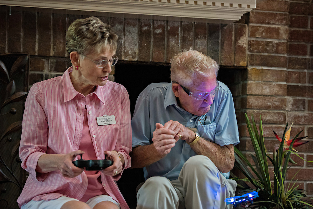 PORT CHARLOTTE, FLORIDA - JUNE 22, 2016: A drone class at a retirement community in Port Charlotte, Fla. helps the residents with hand-eye coordination, problem solving, muscle control, and agility. With the number of dementia cases rising, brain fitness has been a hot topic in retirement communities. Drone expert Tom Whyte, right, flinches and squirms out of the way of the palm-sized quadcopter Rose Beach is learning how to steer during her first flight.  (Photo by Melissa Lyttle for the New York Times)