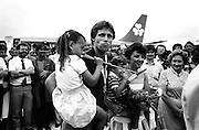 Gold medallist Eamonn Coughlan is surrounded by press and supporters on the tarmac of Dublin Airport on his return from the World Athletic Championships in Finland. His wife Yvonne and children Suzanne (four) and Eamonn Jr (two) are with him. His mother Kathleen looks on.<br />