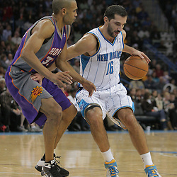 03 December 2008: New Orleans Hornets forward Peja Stojakovic (16) works against Phoenix Suns forward Grant Hill (33) during a 104-91 victory by the New Orleans Hornets over the Phoenix Suns at the New Orleans Arena in New Orleans, LA..