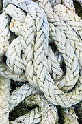 Fishingman's old hemp rope in plaited loops at a harbour on the West Coast of Scotland