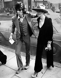 Oct. 24, 1973 - London, England, U.K. - KEITH RICHARDS, the guitarist of the famous British rock group The Rolling Stones, the longest surviving group in the history of rock and roll and his girlfriend ANITA PALLENBERG on their way to court after both had been fined for drug offences. (Credit Image: © Keystone Press Agency/Keystone USA via ZUMAPRESS.com)