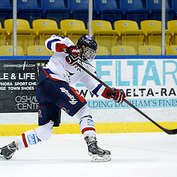 WHITBY, ON - Nov 27 : Ontario Junior Hockey League International Exhibition, between the Whitby Fury and the visiting Adler Mannheim from Germany. Mannheim player shoots the puck during first period game action.<br /> (Photo by Tim Bates / OJHL Images)