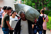 YONGJI, CHINA - JUNE 08: (CHINA OUT) <br /> <br /> Students Carry Daily Necessities Back Home After College Entrance Examination<br /> <br /> Students and parents carry daily articles and books back home after the college entrance examination on June 8, 2016 in Yongji, Shanxi Province of China. The China\'s Annual College Entrance Examination lasts two days and ends on Wednesday. <br /> ©Exclusivepix Media