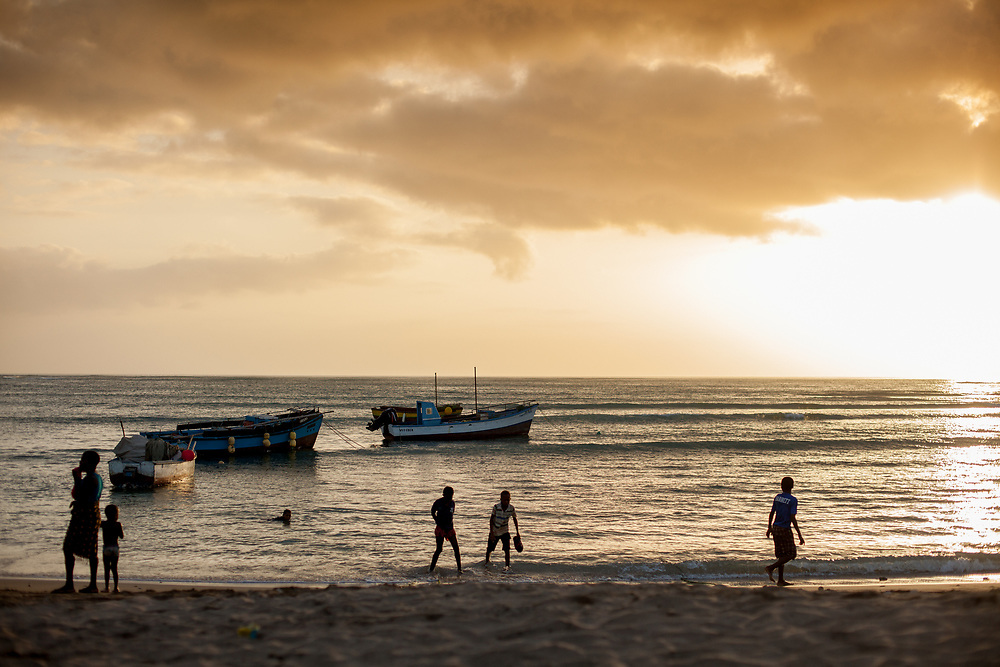 Children playing in a sunset on the beaches of Maio Island, Cabo Verde.