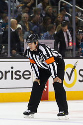Dec 21, 2011; San Jose, CA, USA; NHL referee Dave Jackson (8) before a face off between the San Jose Sharks and the Tampa Bay Lightning during the second period at HP Pavilion. San Jose defeated Tampa Bay 7-2. Mandatory Credit: Jason O. Watson-US PRESSWIRE