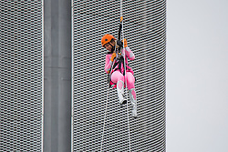 © Licensed to London News Pictures. 28/04/2018. Brighton, UK. Members of the public abseil from the I360 tower pod in aid of the Rockinghorse Children's Charity as grey clouds and colder weather hits Brighton and Hove. Photo credit: Hugo Michiels/LNP