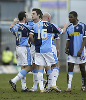 Photo: Aidan Ellis.<br /> Mansfield Town v Wycombe Wanderers. Coca Cola League 2. 24/02/2007.<br /> Wycombe's Scott McGleish (L) is congratulated by Team mates after scoring the first goal