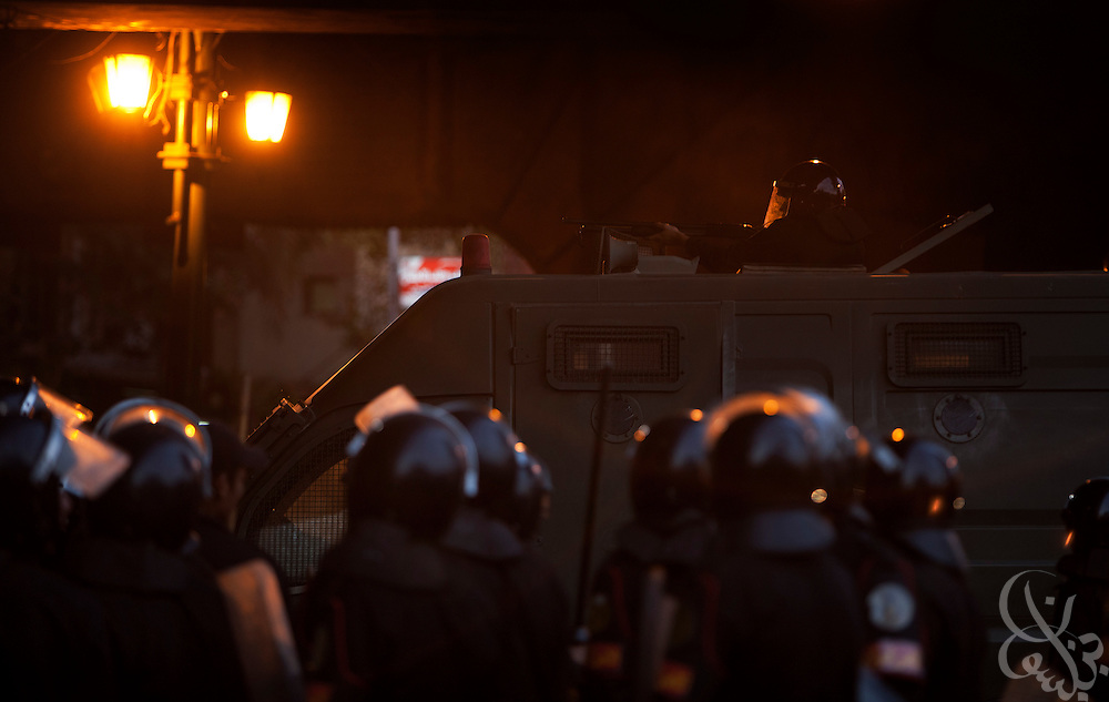 An Egyptian riot police tear gas grenadier fire at protesters during continuing January 26, 2011 demonstrations in downtown Cairo, Egypt. A series of unprecedented demonstrations have broken out across Egypt for the past two days, inspired by the revolution in Tunisia, and intended to spark a similar movement in Egypt. (Photo by Scott Nelson)