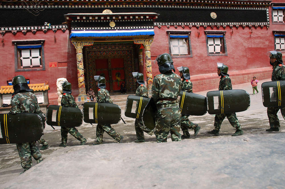 Chinese soldiers marching past the Bakong Monastery, in Dege - taken March 20, 2008 - Michael Benanav - 505-579-4046