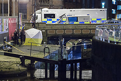 "© Licensed to London News Pictures . Manchester , UK . FILE PICTURE DATED  06/10/2013 of a forensic tent beside the canal , containing a body recovered from the canal . Police pulled a body from The Bridgewater Canal in Manchester , adjacent to the City's "" Gay Village "" on Canal Street . Greater Manchester Police have issued a statement after suggestions that a number of deaths in and around Manchester's canals may be linked to a serial killer , named in local folklore as "" The Pusher "" . The statement said "" Absolutely no evidence whatsoever of foul play has been established "" . Photo credit : Joel Goodman/LNP"