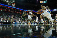 21 MAR 2015: Norman Powell (4) of University of California - Los Angeles breaks away from the University of Alabama - Birmingham defense during the 2015 NCAA Men's Basketball Tournament held at the KFC Yum! Center in Louisville, KY. UCLA defeated UAB 92-75. Brett Wilhelm/NCAA Photos