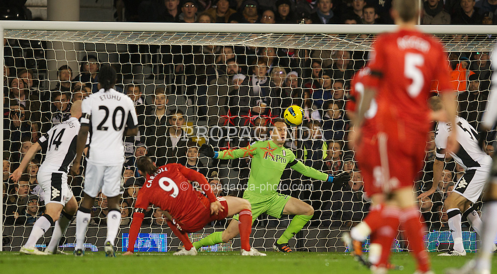 LONDON, ENGLAND - Monday, December 5, 2011: Liverpool's Andy Carroll is denied a goal by Fulham's goalkeeper Mark Schwarzer during the Premiership match at Craven Cottage. (Pic by David Rawcliffe/Propaganda)