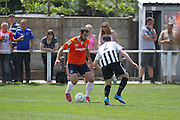 Luton Town Alex Lawless takes on Peacehaven Jon Marzetti during the Pre-Season Friendly match between Peacehaven & Telscombe and Luton Town at the Peacehaven Football Club, Peacehaven, United Kingdom on 18 July 2015. Photo by Phil Duncan.