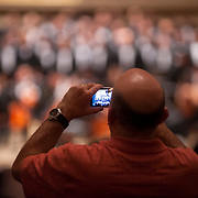 December 12, 2012 - New York, NY : A concertgoer snaps a cell phone photo during the intermission of Tuesday evening's performance by the Westminster Symphonic Choir and the Simón Bolívar Symphony Orchestra -- lead by Conductor Gustavo Dudamel -- at Carnegie Hall's Stern Auditorium / Perelman Stage.  CREDIT: Karsten Moran for The New York Times