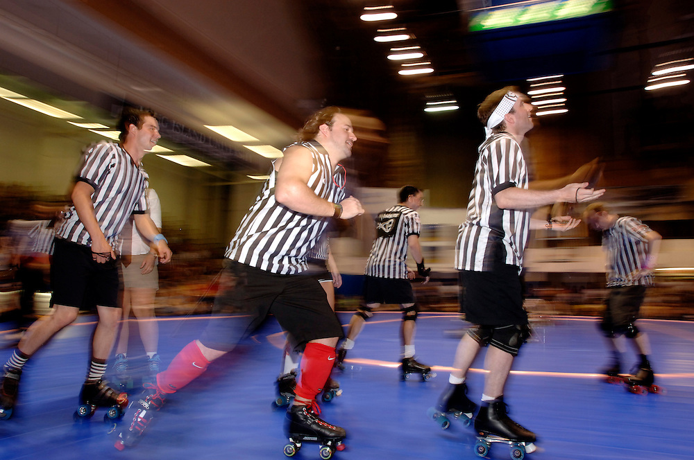 Gotham Girl's Roller Derby at  Long Island University's Schwartz Athletic Center Women's Roller Derby. The Brooklyn Bombshells (black and white stripes) battle it out against the Bronx Gridlock.USA New York
