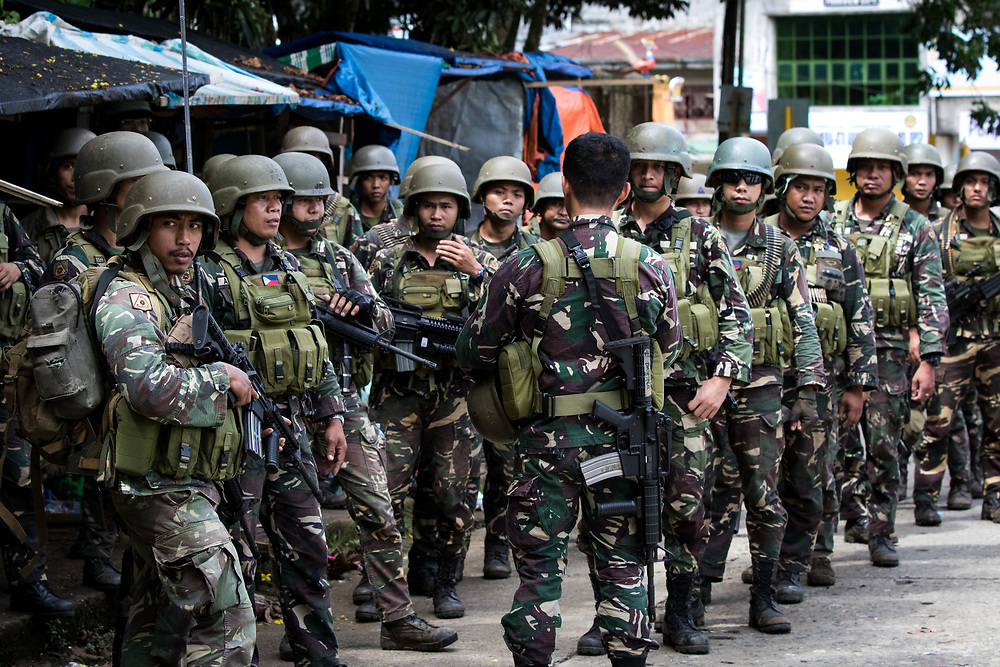 MARAWI, PHILIPPINES - JUNE 6: Government troops listens to instructions of the officer before search operation of firearms and explosives inside a restricted area of Marawi City in Southern Philippines, June 6, 2017. (Photo: Richard Atrero de Guzman/NUR Photo)